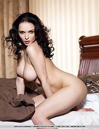 Dreamy, bedroom range of vision with sultry gaze, her conclave in erotic poses portraying pire lust and passion, baring her large yet delicate assets, Jenya is one exquisitely sensual model.