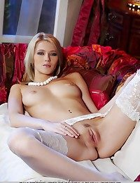 Enticing blonde in dainty white stockings take matching colours stripe and white stiletto shoes.