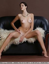 Elegantly magnificent brunette with long, amerce body, added to perky assets.