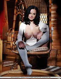 Raven-haired Lana with her amazing, large breasts plus stockinged feet.